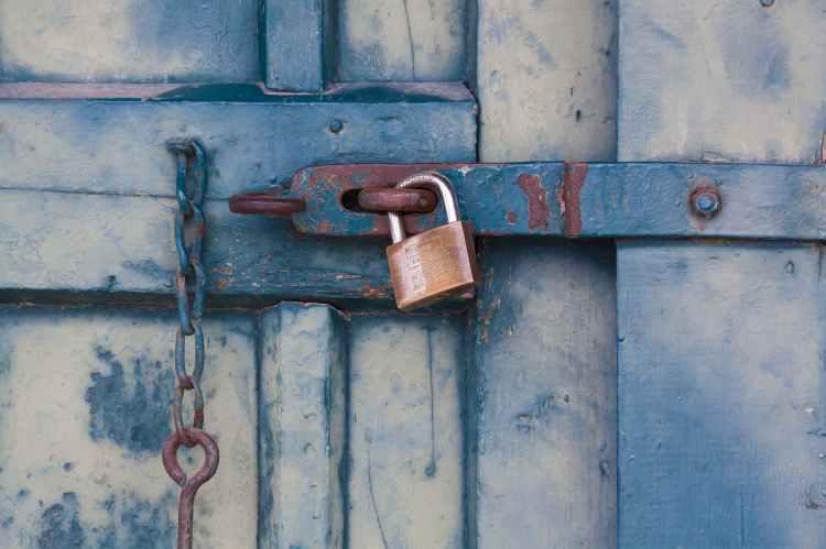 gold padlock locking door