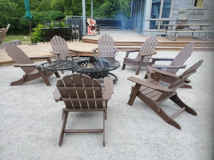 Lounge by the fire at Long Point Marshview Patio
